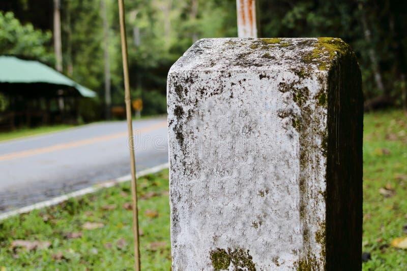 White milestones on countryside road. Old white milestones on countryside road . Selective focus on old Milestones stock images
