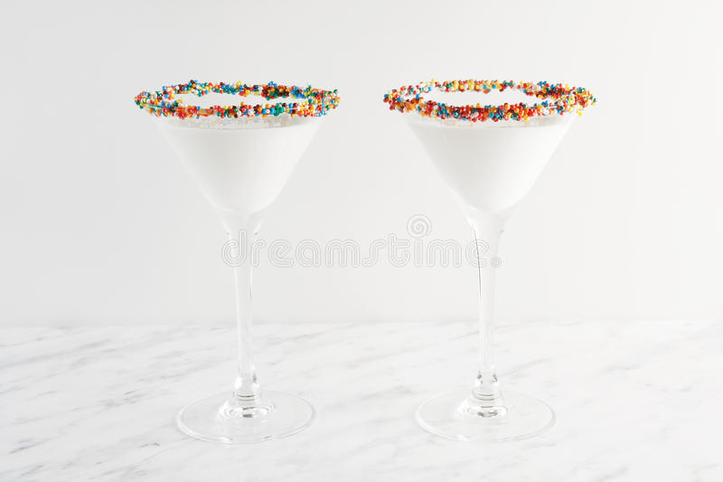 White milk cocktail, close-up. Decorated with jelly hearts. royalty free stock images