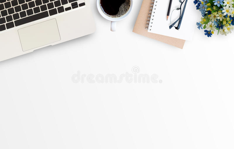 White minimal office desk table with laptop computer royalty free stock photography