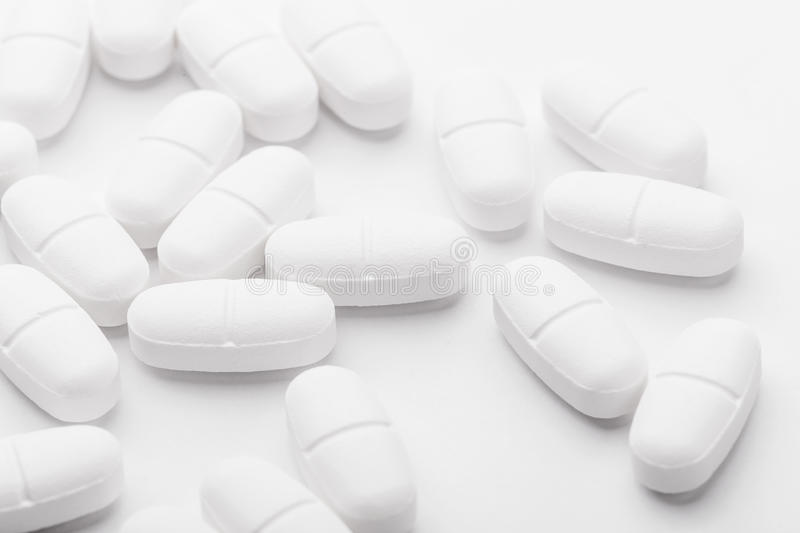 White mixing pills stock images