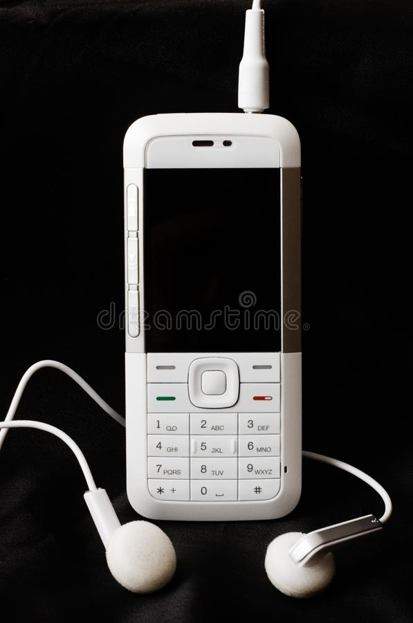 Download White mobile phone stock photo. Image of player, plug - 7883196
