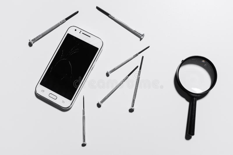 A white mobile phone is broken screen on white background.blank for copy space. isolated.  royalty free stock photo