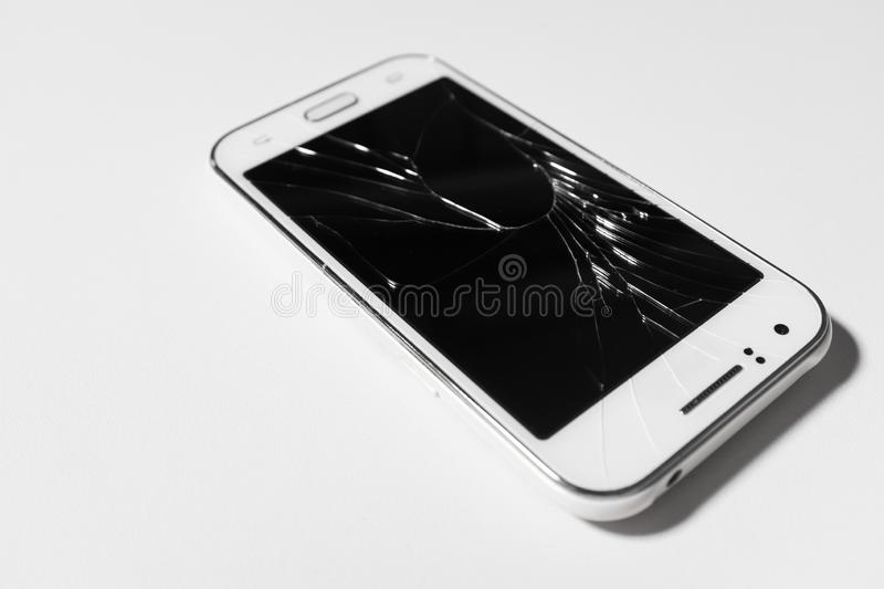 A white mobile phone is broken screen on white background.blank for copy space.  royalty free stock photos