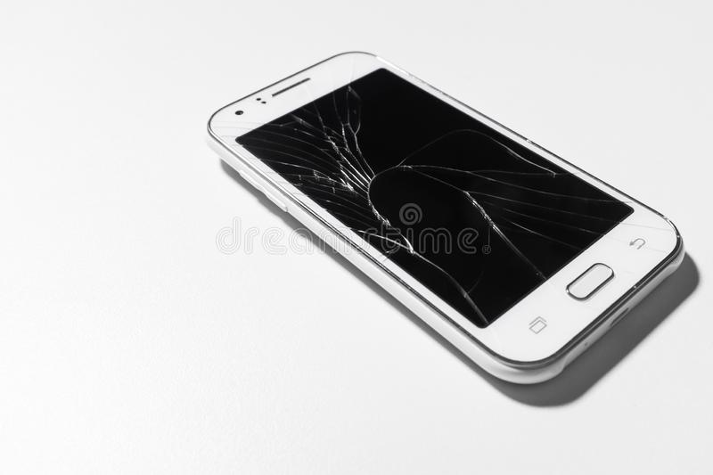 A white mobile phone is broken screen on white background.blank for copy space.  stock image