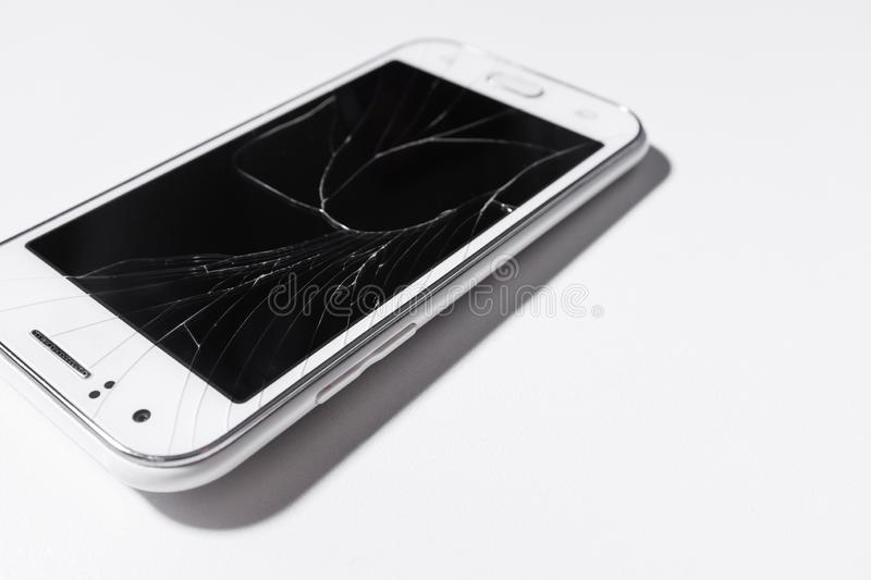 A white mobile phone is broken screen on white background.blank for copy space.  stock images