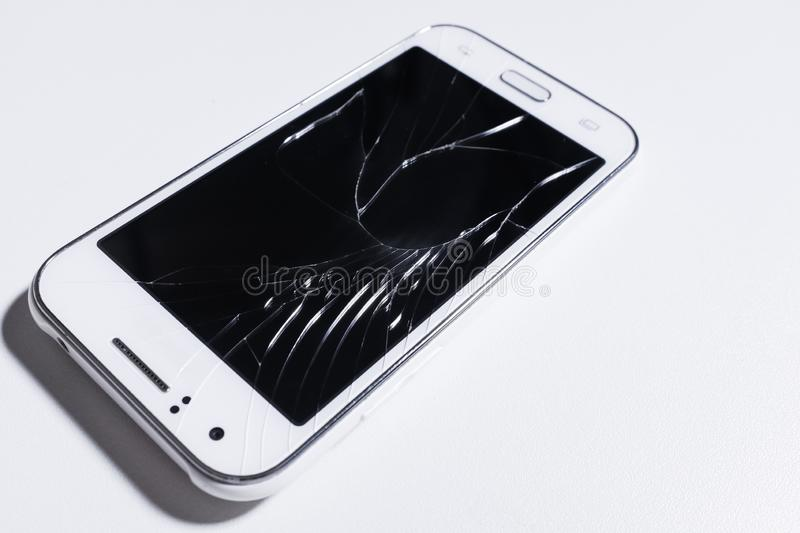 A white mobile phone is broken screen on white background.blank for copy space..  stock photos