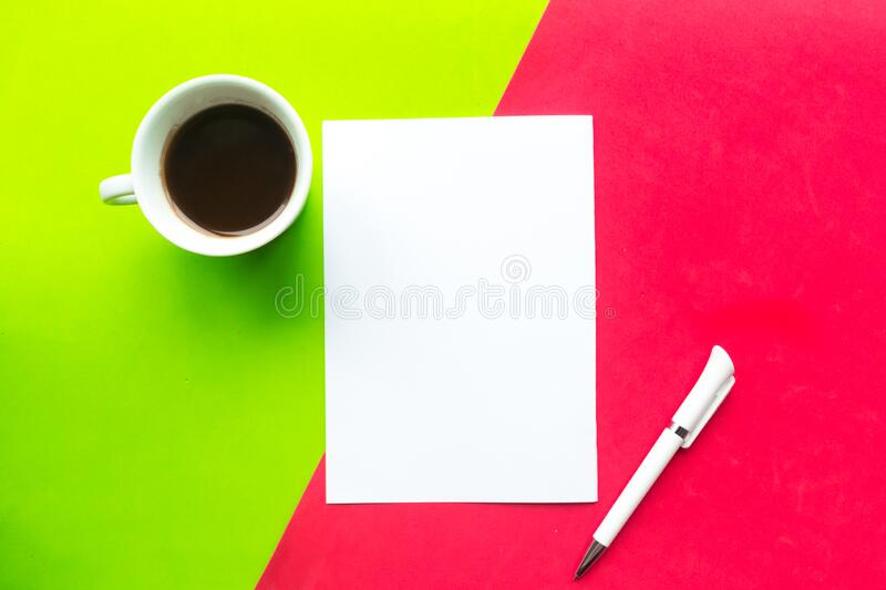 White mockup blank, coffee cup and pen on geometric red and green background. Flat lay, top view, copy space royalty free stock image