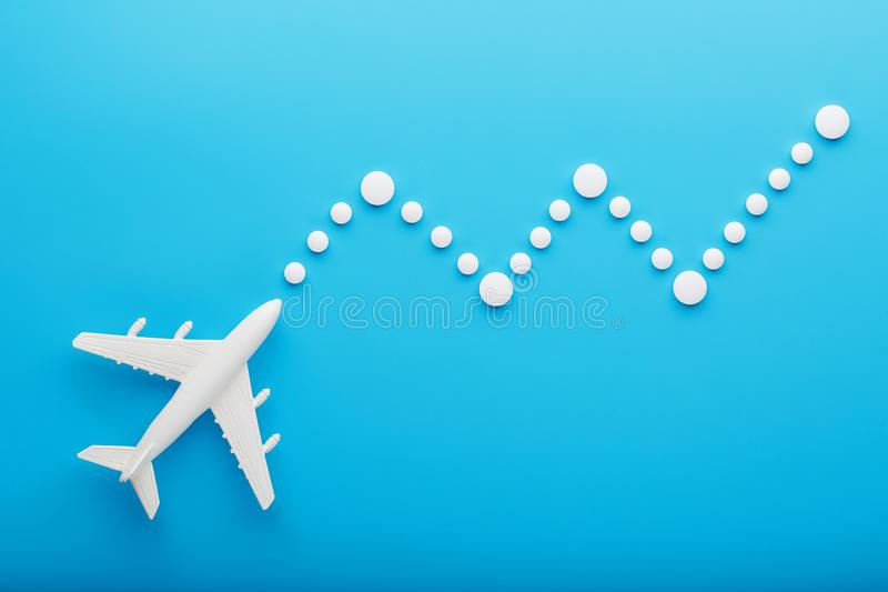 White model of a passenger plane with dotted trajectory points isolated on background. The route of the aircraft in the countries stock image