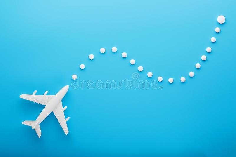 White model of a passenger plane with dotted trajectory points isolated on background. The route of the aircraft in the countries royalty free stock photos