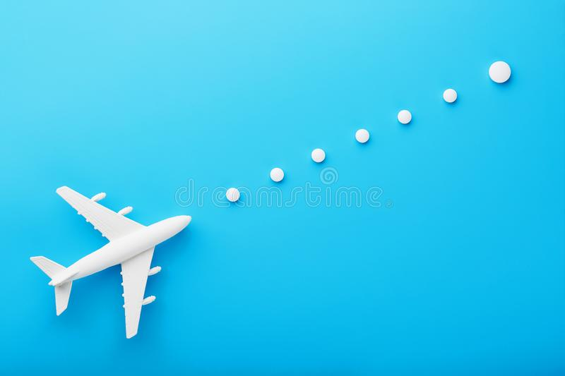 White model of a passenger plane with dotted trajectory points isolated on background. The route of the aircraft in the stock photo