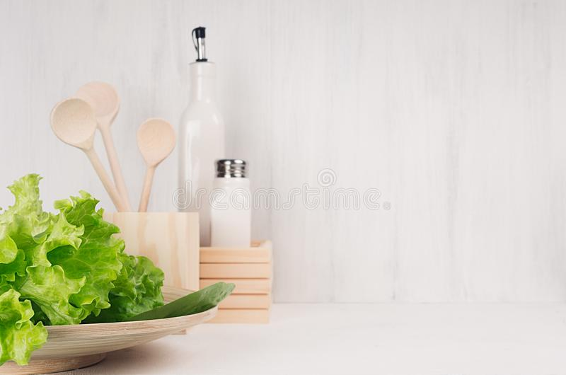 White Modern Kitchen Decor With Beige Natural Wooden Dish Utensils Fresh Green Salad On Wood Background Stock Photo Image Of Kitchen Table 109641664