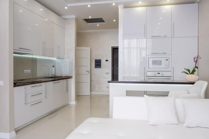 White modern kitchen in a house with a beautiful design royalty free stock photo