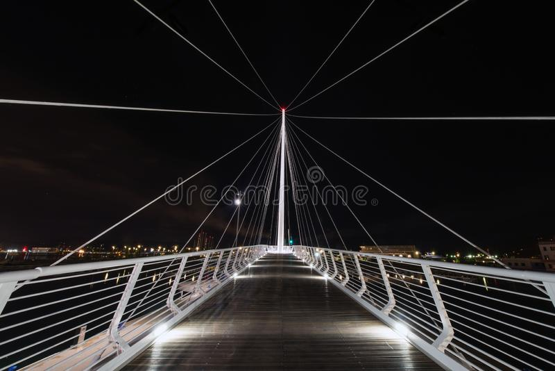 A white and modern pier port by night in Lucca. Italy stock image