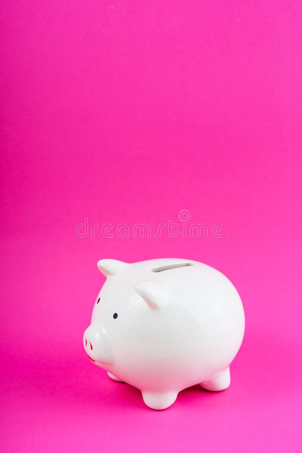 White Money Save Pig on Pink Background Copy Space. Finance Box Concept. Empty Budget Ceramic Moneybox Symbol. Cash Safe Box Business Object royalty free stock photography