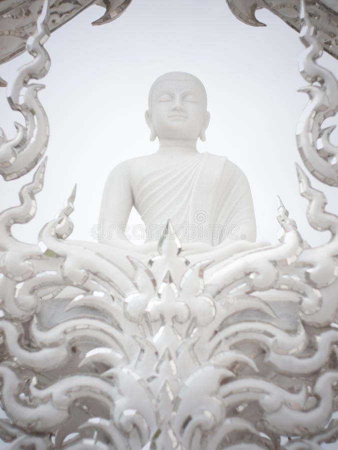 White monk figure in the rongkhun temple, Thailand. White monk figure is in the rongkhun temple, Thailand royalty free stock image
