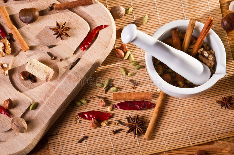White mortar and different kinds of spices royalty free stock images