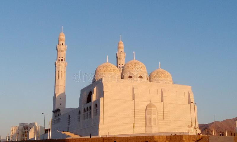 White mosque religious place in muscat oman and peace for mind to do prayer royalty free stock image