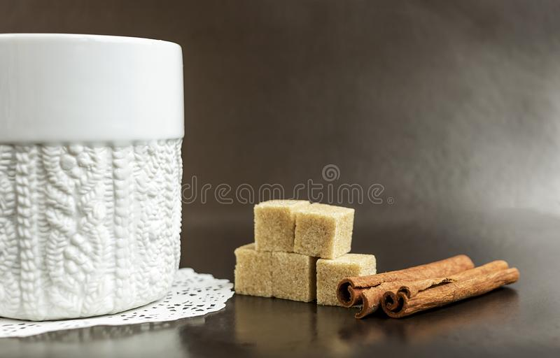 White mug with coffee on a dark background with sugar stock photo