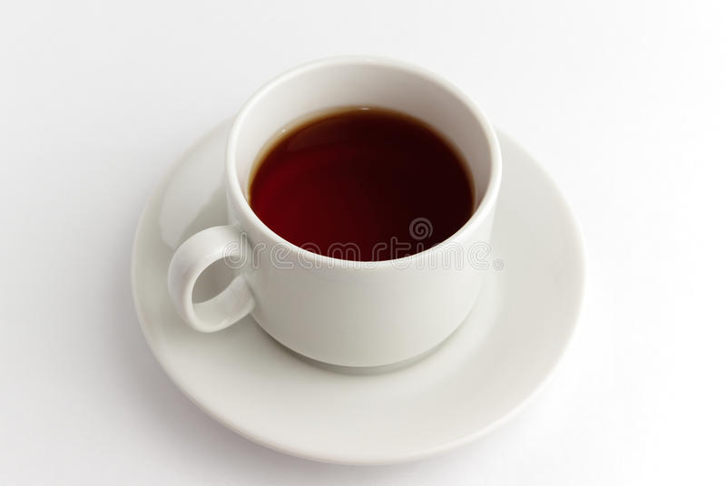 Cup tea. White mug with hot fragrant tea on a silver platter royalty free stock photo