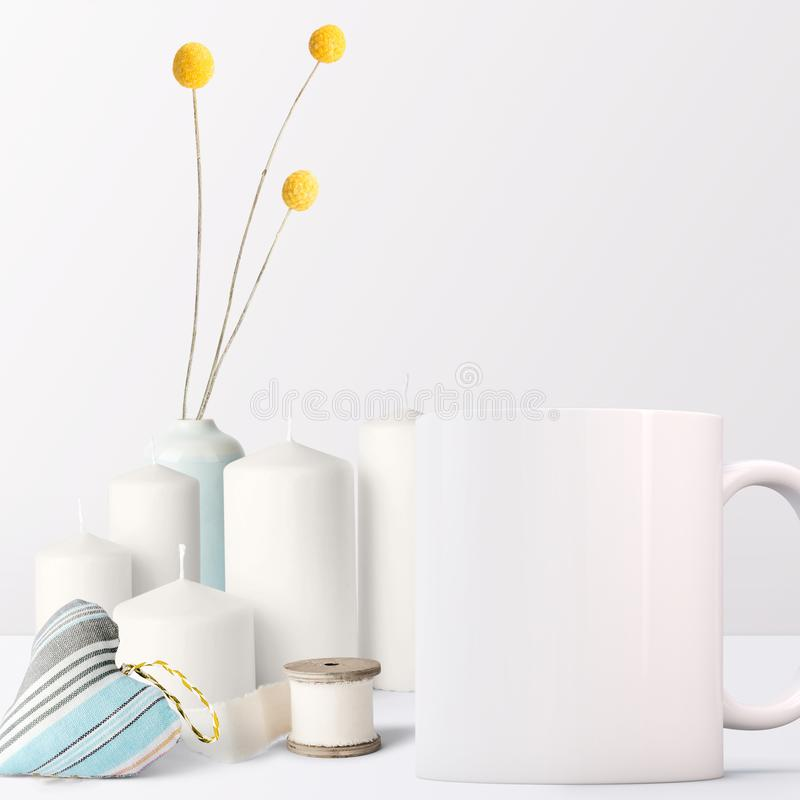 White Mug Mockup - feminine style. Pretty Mug Mockup setup with candles and sewing items. Great for overlaying your custom quotes and designs for selling mugs royalty free stock images