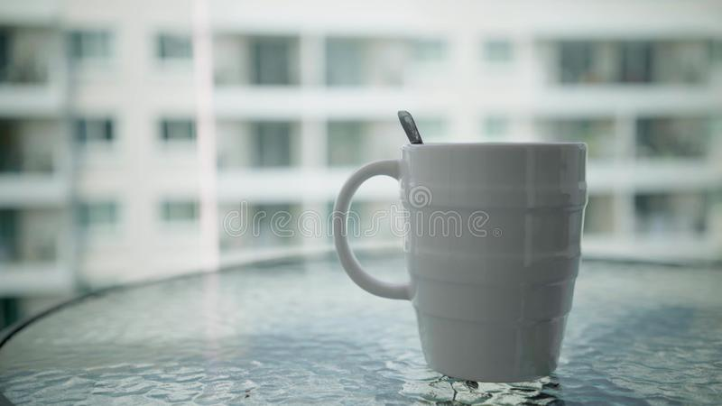 White mug on table and modern room background. stock photography