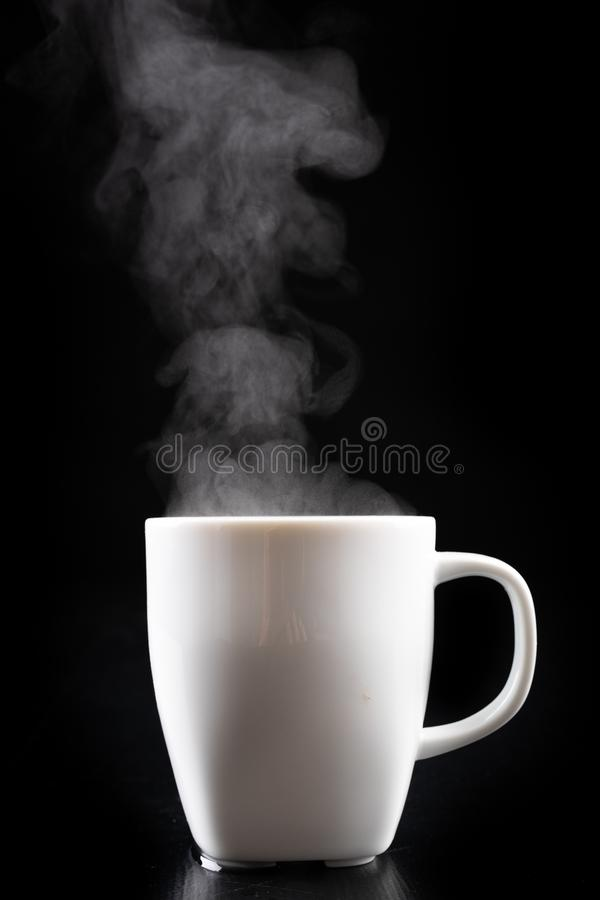 White mug and water vapor. Freshly brewed hot drink royalty free stock photography