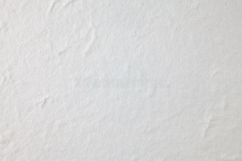 White Mulberry paper background. Abstract, aged, antique, art, beautiful, beauty, blank, brown, cards, color, craft, crumpled, crunch, decorative, design stock images