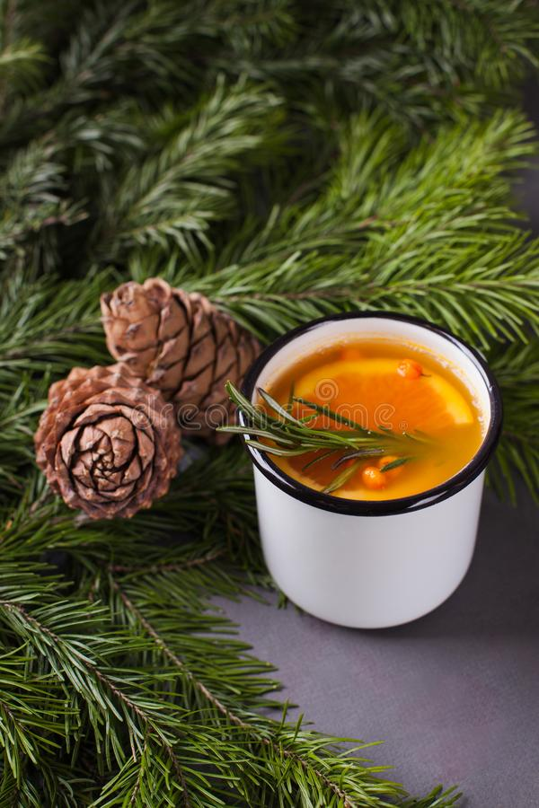 White mulled wine with various spices on a grey background with fir tree ande cones. Hot alcoholic beverage, winter and fall. Autumn drink stock photos