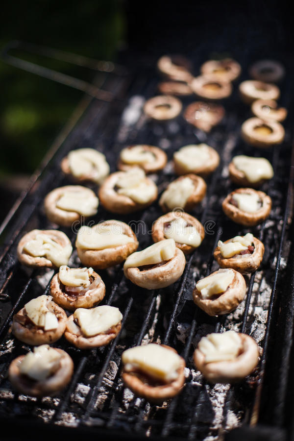White mushrooms grilled BBQ steam stock images