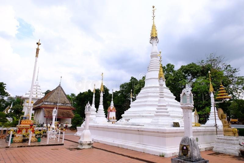 The white Myanmar Pagoda in front of ancient Thai style ordination hall at Nonthaburi, Thailand December 2018. The white Myanmar Pagoda style in front of ancient stock images