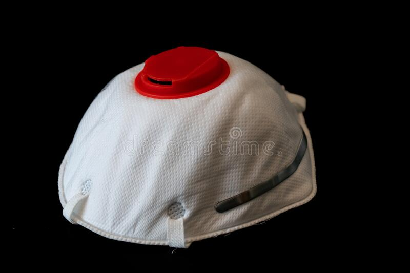 N95 respirator face mask with red filter isolated on black background stock image