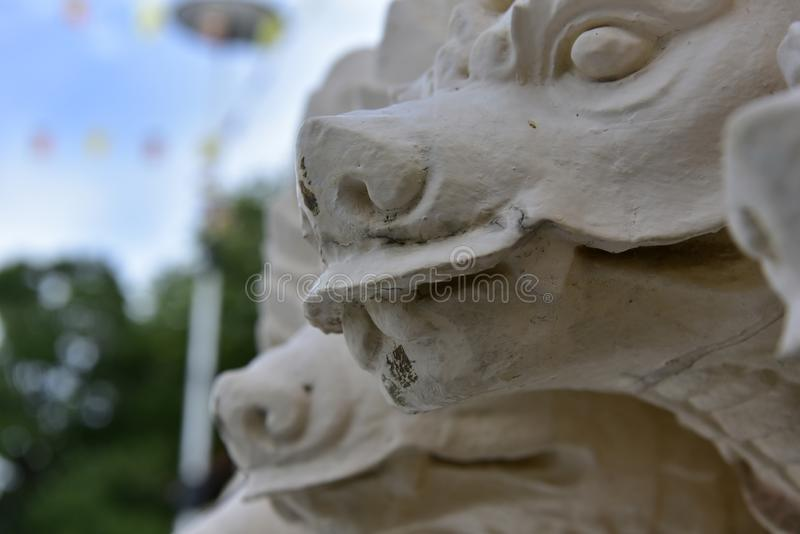 White Naga stucco statue at the entrance to the temple stock photo