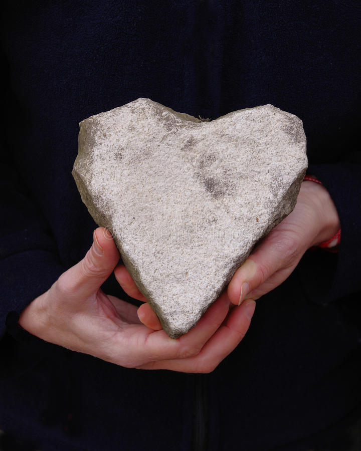 Download White Natural Stone Heart In Hands Stock Photo - Image: 38946485