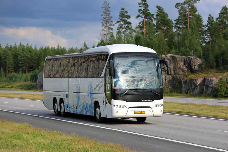 White Neoplan Tourliner Coach Bus on Motorway stock photography