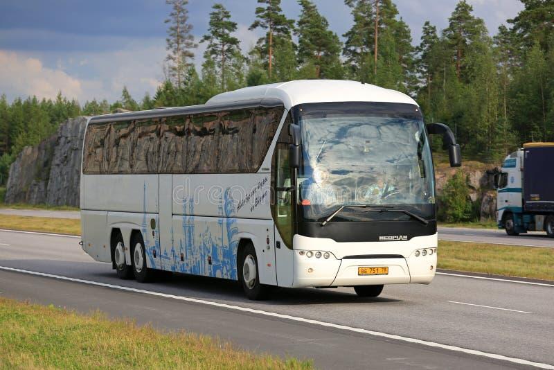 White Neoplan Tourliner Coach Bus in Motorway Traffic royalty free stock photos