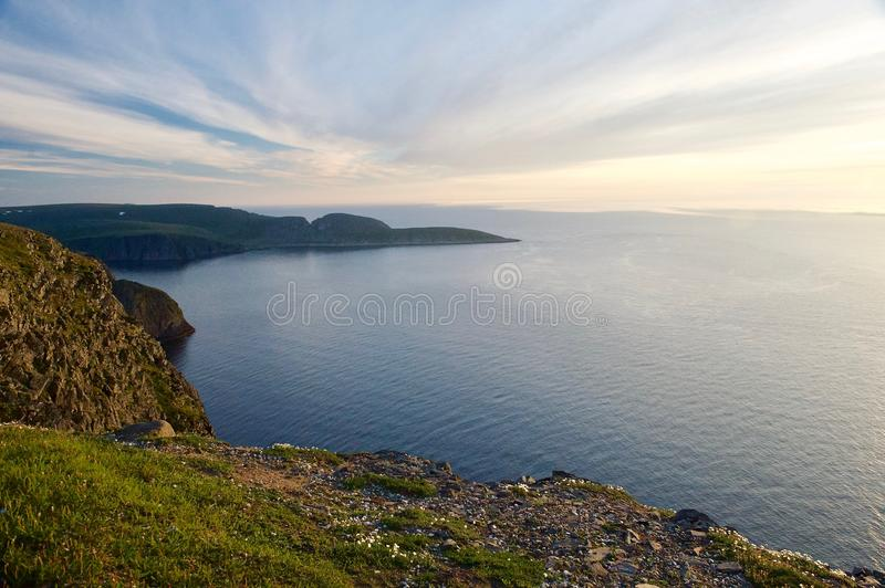 White night on Nordkapp , Norway. At the end of the Earth. Sunset when white nights go on. Nordkapp, Norway. This is midnight time. Sunlight reflection on the royalty free stock photos
