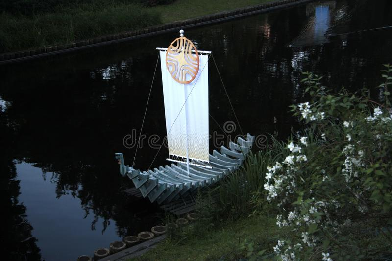 White nights on the canal in Riga. Beautiful installation in the white nights on the canal in Riga stock image