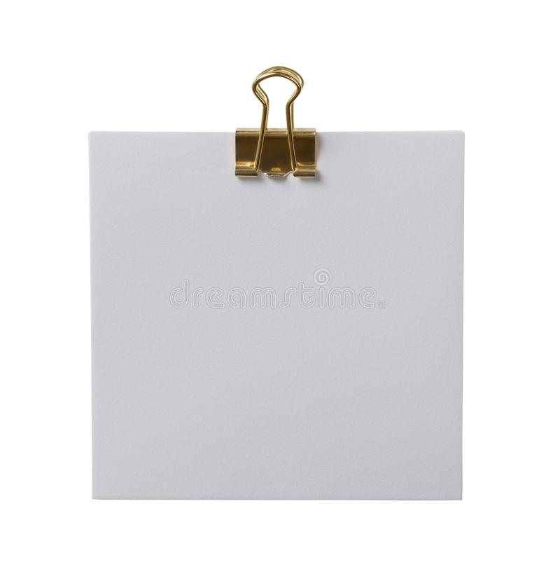 White note with a golden paperclip royalty free stock photo