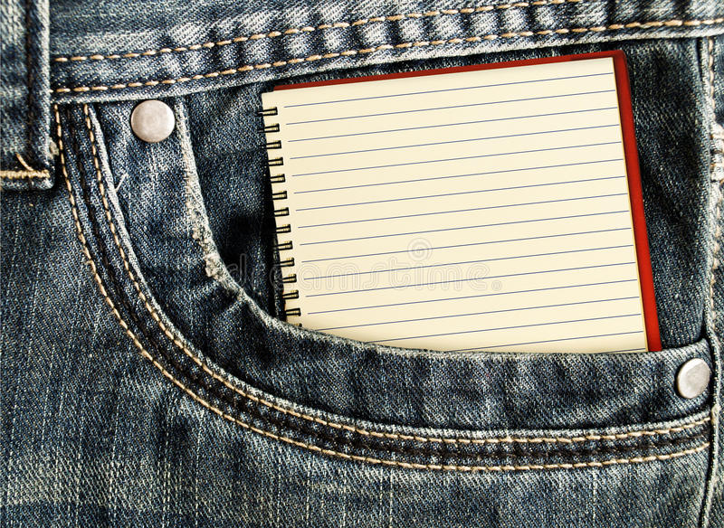 White notebook in jeans pocket stock images