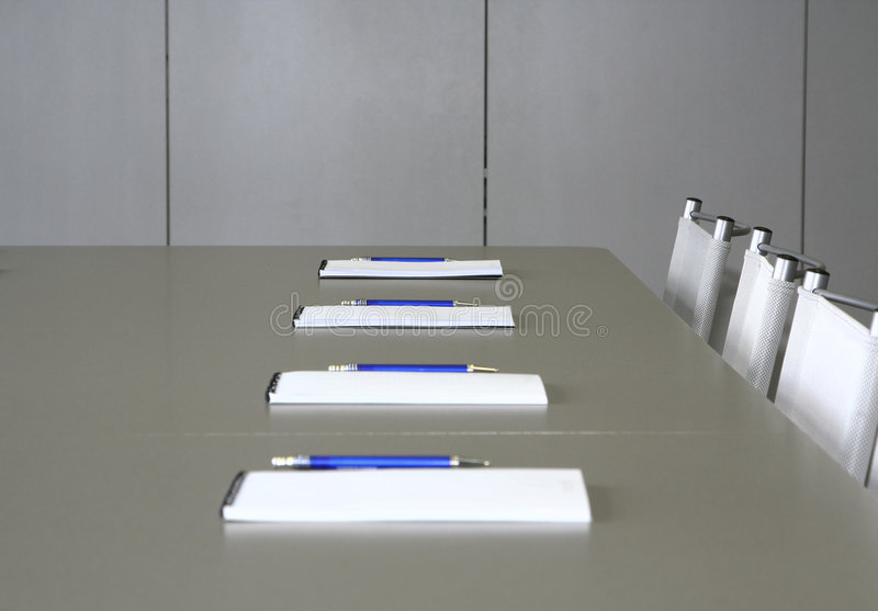 White notebooks laying on a grey table for negotia stock image