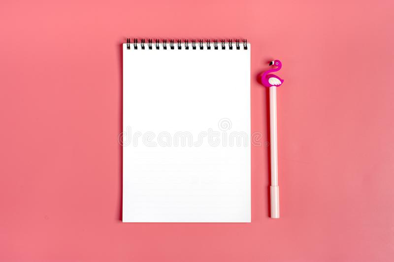 White Notepad, Clips, Pen In The Shape Of A Flamingo On A ...