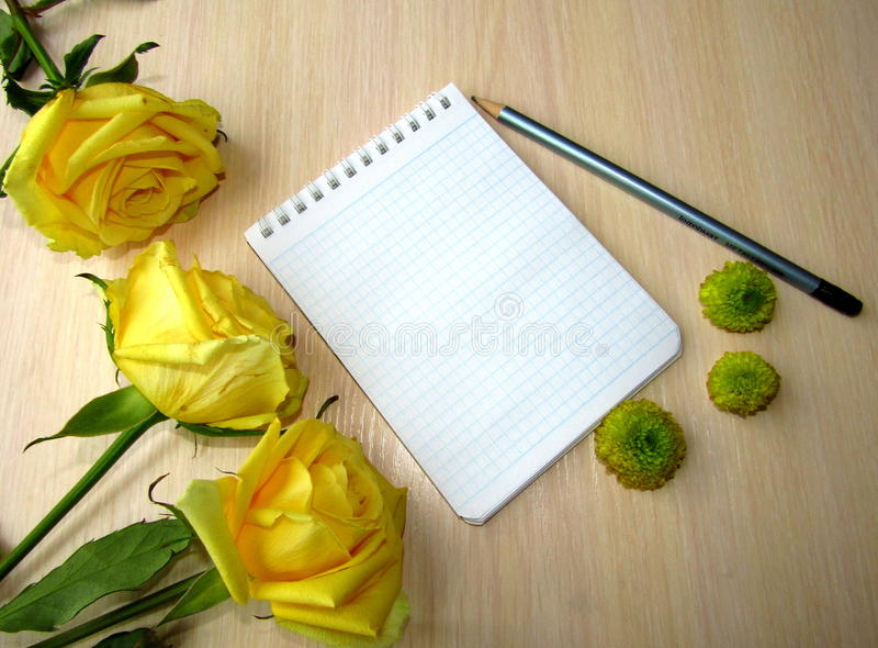 White Notepad for writing text with yellow flowers royalty free stock photography