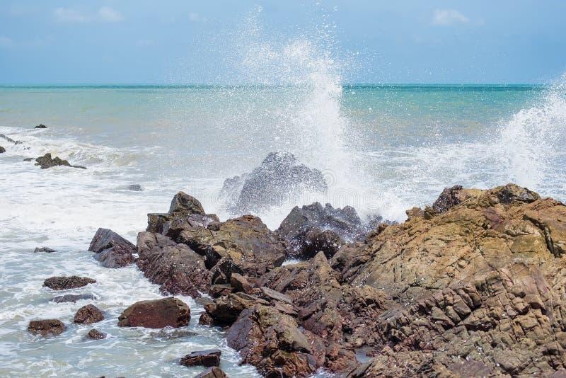 White ocean waves crashing over coastal sea rocks in summer.Thailand. White ocean waves crashing over coastal sea rocks in summer.Thailand royalty free stock photos