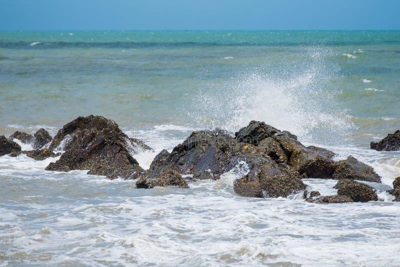 White ocean waves crashing over coastal sea rocks in summer.Thailand. White ocean waves crashing over coastal sea rocks in summer.Thailand royalty free stock photography