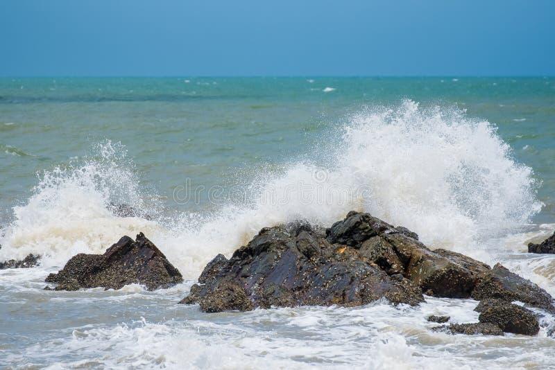 White ocean waves crashing over coastal sea rocks in summer.Thailand. White ocean waves crashing over coastal sea rocks in summer.Thailand stock photos