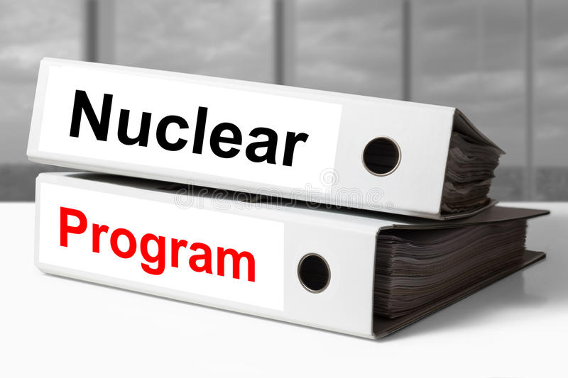 White office binders nuclear program. Stack of white office binders nuclear program stock photography