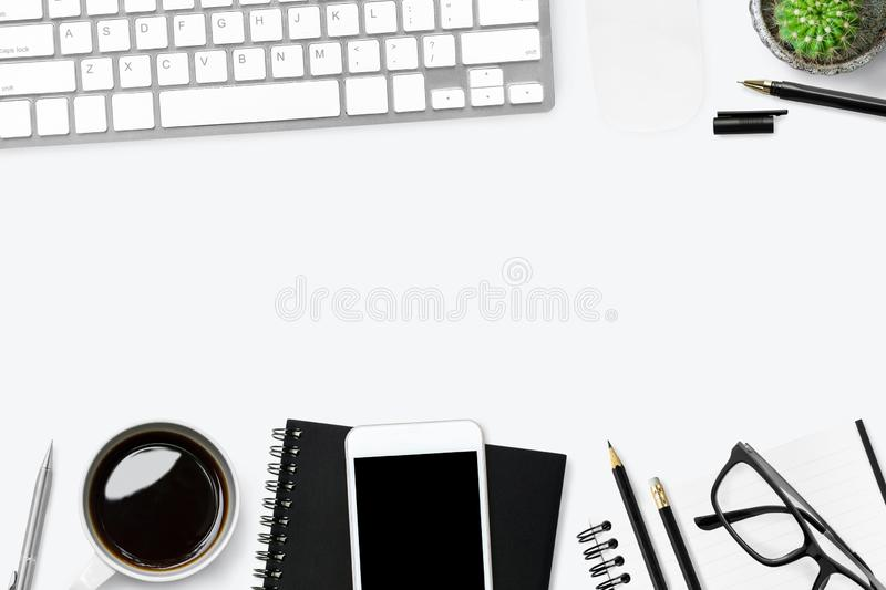 White office desk table with computer gadgets and office supplies. Top view with copy space, flat lay stock photography