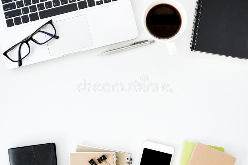 White office desk table with a lot of things on it. Top view with copy space, flat lay stock image