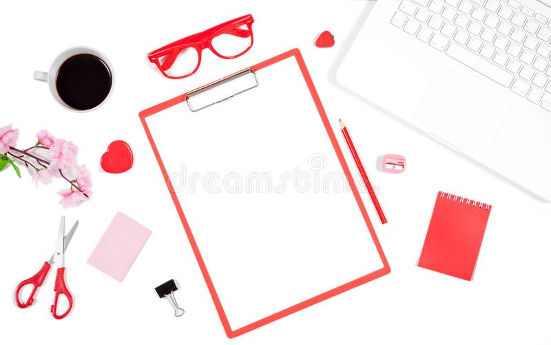 White office desk table with notebook, computer keyboard, clipboard and office supplies royalty free stock images