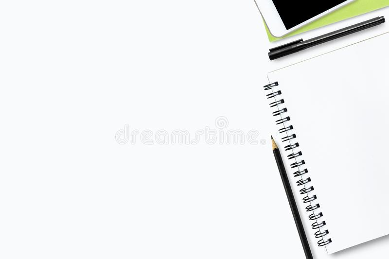 White office desk table with notebook and supplies. Top view with copy space, flat lay stock image